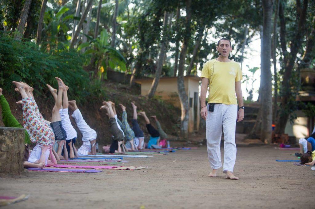 Teaching yoga at the lake side, Kerala